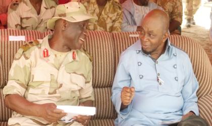 Nigeria Defence Academy (NDA) Commandant, Maj-Gen. Mahmud Yerima (left) discussing with Senate Leader, Tunde Akogun at the NDA Desert Warfare Cadets Training in Yusufari, Yobe State, last Saturday.