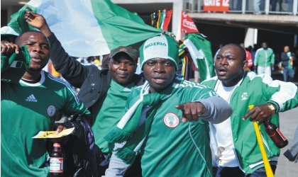 Nigerians in South Africa cheering the Super Eagles, during their 2010 FIFA World Cup Group B match against Argentina, last Saturday.