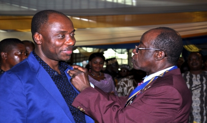 Rivers State Governor, Rt. Hon. Chibuike Rotimi Amaechi (left) being decorated by Sir Gabriel Toby, District Governor of Rotary International, District 9140 during his investiture in Port Harcourt