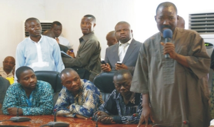Chairman, Nigeria Union of Journalists (NUJ), Lagos State Council, Mr Wahab Oba (right), making a speech on behalf of his freed colleagues at Government House, Umuahia, Abia State capital, shortly after regaining their freedom, yesterday.
