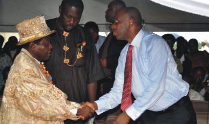 Governor Chibuike Amaechi  of Rivers State (right) exchanging pleasantries with King Prof. T.J.T Princewill, the Amanyanabo of Kalabari Kingdom, during the Governor's Town Hall meeting in Buguma, Asari -Toru Local Government Area, last Friday.