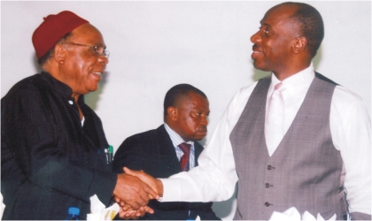 Governor Chibuike Rotimi Amaechi of Rivers State (right) in a handshake with the National Chairman, Forum of States Independent Electoral Commission of Nigeria, Prof S.O.Enejuaiwe, during the formal presentation of a book,  'Making The Votes Count,' at the House of Assembly Complex, Port Harcourt,  yesterday.     Photo: Chris Monyanaga