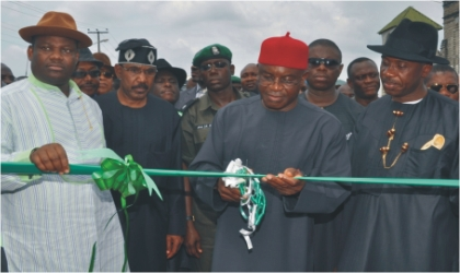 Senate President David Mark (middle) cutting the tape to commission Okrika Ring Road in Rivers State .With him are  Governor  Chibuike Rotimi Amaechi of Rivers State (right),  Senator  Olorunmbe Mamora (2nd left) and Engr. Tele Ikuru, Deputy Governor of Rivers State.