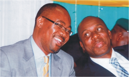 Rivers State Governor, Rt. Hon. Chibuike Rotimi Amaechi (right) chatting with Permanent Secretary, Federal Ministry of National Planning, Prof Sylvester Monye, during a two-day South-South zonal dialogue and policy sensitisation workshop organised by United Nations Development Programme (UNDP) and Nigeria Governors' Forum (NGF) in Port Harcourt, yesterday. Photo: Chris Monyanaga