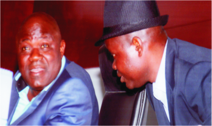Speaker, Rivers State House of Assembly, Rt. Hon. Tonye Harry (left) listening to House Committee chairman on Local Government, Hon Ikuinyi-Owaji Ibani, during the sitting of the House, yesterday. Photo: Chris Monyanaga