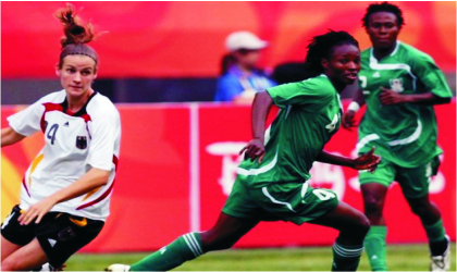 Super Falcons' striker, Perpetua Nkwocha (middle) during  last week's friendly with Germany