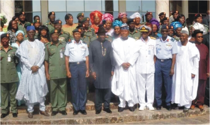 President Goodluck Jonathan(middle) in a group photograph with Service Chiefs, newly decorated army officers and their wives, in Abuja, yesterday.