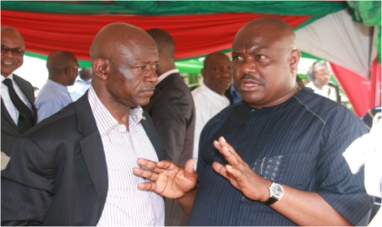 Director-General, Governor Chibuike Rotimi Amaechi's Campaign Organisation, Chief Nyesom Wike (right) chatting with Rivers State Attorney-General and Commissioner for Justice, Barrister Ken Chikere, during the commissioning of the governor's campaign secretariat, in Port Harcourt, on Tuesday.