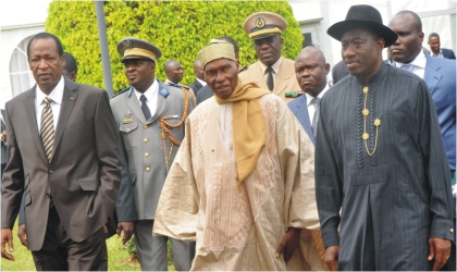 L-R: President Blaise Compaore of Burkina Faso, President Abdulahi Wade of Senegal and President Goodluck Jonathan arriving for an Economic Community of West African States (ECOWAS) Summit On Cote D'Ivoire, in Abuja last Friday.