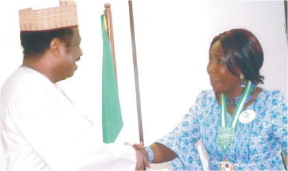 Hon Minister of State for Health, Alhaji Suleman Bello in a handshake with the District Governor, Lions Clubs International District 404A (Nigeria) Lion Dame Joy Peterba Warmate, when she paid a courtesy visit, in Abuja, recently.