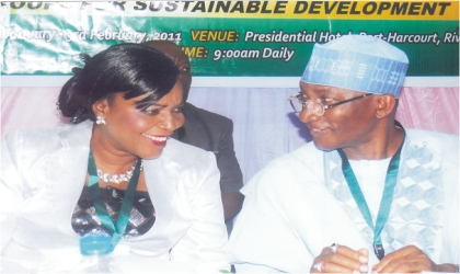 Permanent Secretary, Federal Ministry of Women Affairs, Alhaji Idris Kuta (right) chatting with his colleague from Women Affairs, Dr Pat Ogbunaga, during the 13th Regular Council Meeting of the National Council on Women Affairs and Social Development, at Hotel Presidential, Port Harcourt, on Monday.