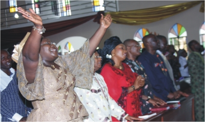 Commissioner of Information and Communications, Mrs Ibim Semenitari, praising God during the thanksgiving/re-dedication service of the ministry, held at St. Nicholas (Ang) Church, Woji Deanery, last Sunday.