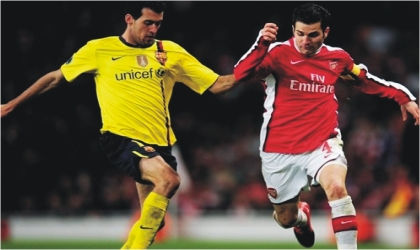 Arsenal's Cesc Fabregas (right) and Sergio Busquets of Barcelona. Both are expected to clash in midfield  today