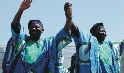 President Goodluck Jonathan (right) and Vice President Namadi Sambo, acknowledging cheers in Jos during the PDP presidential campaign, yesterday