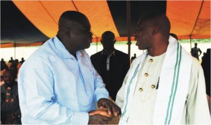 Rivers State Governor, Rt Hon Chibuike Rotimi Amaechi (right) exchanging pleasantries with Chief Sergent Awuse during the burial of Late Madam  Rachael William Uchendu Osi at Mgbuitanwo, Emohua, on Saturday.