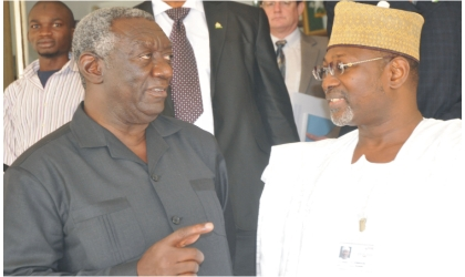 Former Ghanaian President, Mr John Kuffour (left), discussing with Chairman, Prof. Attahiru Jega,  Independent National Electoral Commission, during his visit to INEC office in Abuja, yesterday
