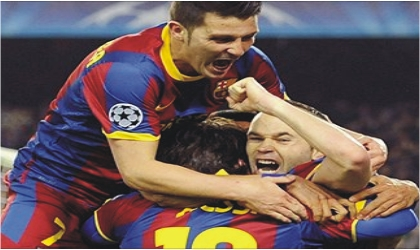 Barca players celebrating their victory over Arsenal, yesterday at the Nou Camp