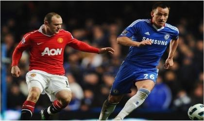 Man Utd's Wayne Rooney (left) putting pressure on Chelsea's skipper, John Terry in a previous  encounter.