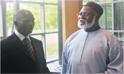 Former South African President, Thabo Mbeki (left) and former Nigerian  Head of State, Abdulsalami Abubakar at the Nigerian Embassy in Washington D.C  after a consultative meeting of the AU Special Panel for Sudan, recently.