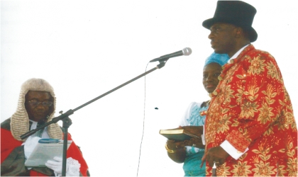 Governor of Rivers State, Rt Hon Chibuike Rotimi Amaechi with his wife, Dame Judith,  taking oath of office during the swearing-in ceremony at Liberation Stadium, last Sunday