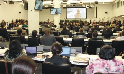 Audience listening to a 12-year old Nigerian girl, Ebubechukwu Taylor, addressing World Leaders at the launch of a global plan for the elimination of new infections among children and keeping their mothers alive at the UN Headquarters in New York.