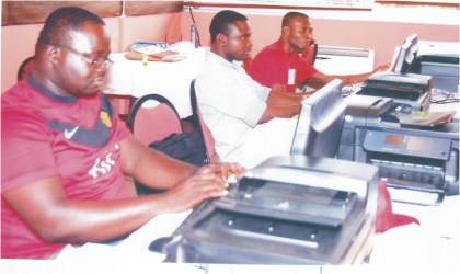 Journalists at the media centre of the 17th National Sports Festival in Port Harcourt yesterday. Inset, some athletes arriving the Games Village at University of Port Harcourt, Choba, yesterday.