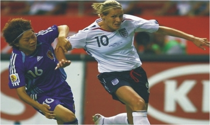 German female player, Popp (10) contesting for the ball against an opponent at the on-going Women World Cup in Germany, yesterday.
