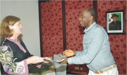 Rivers State Governor, Rt Hon Chibuike Amaechi  receiving  an address from team leader Violaine Mitchel of Bill and Melinda Gates Foundation, USA, on behalf of Global Alliance on Vaccines and Immunisation (GAVI), during a courtesy visit to Government House, Port Harcourt, yesterday.