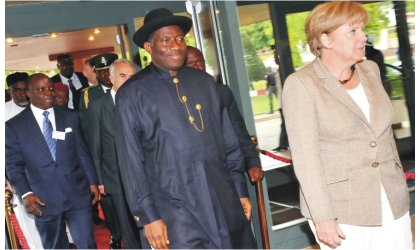 From Left: Gov. Emmanuel Uduaghan of Delta State; President Goodluck Jonathan; and Chancellor of the Federal Republic of Germany,, Dr Angela Merkel, arriving for the 4th German-Nigeria Business Forum in Abuja, yesterday