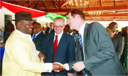 Rivers State Deputy Governor, Engr. Tele Ikuru (left), in a handshake with the deputy Managing Director, Port Harcourt, Total Exploration and Production, Nigeria, Mr. Dennis Berthelot, while, the French Ambassador to Nigeria, Mr. Jean Michel-Dummond, watches delightfully.
