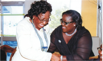 ; Rivers State Information and Communications Commissioner, Mrs Ibim Semenitari (right) chatting with Rotarian Georgiana Ngeri-Nwagha, immediate past President, Rotary Club of Port Harcourt, during  induction of the club's  new president, on Saturday. Photo: Chris Monyanaga