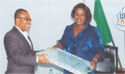 Rivers State Commissioner for Information and Communications, Mrs Ibim Semenitari receiving a present from the General Manager, Rivers State Newspaper Corporation, Mr Celestine Ogolo, when she visited The Tide Newspapers, yesterday. Photo: Dele Obinna