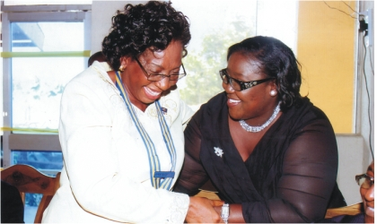 Rivers State Information and Communications Commissioner, Mrs Ibim Semenitari (right) chatting with Rotarian Georgiana Ngeri-Nwagha, immediate past President, Rotary Club of Port Harcourt, during  induction of the club's  new president, on Saturday. Photo: Chris Monyanaga