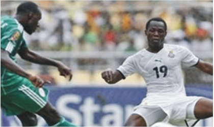Super Eagles player (left) in a tango with Black Stars player yesterday at Vicarage during an international friendly match. The game ended 0-0