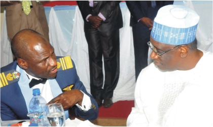 Chief of  Air Staff, Air Marshal Mohammed Umar (left) with Minister of Defence, Dr Haliru Bello at a dinner in honour of senior officers of Air Rank in Abuja, Tuesday.
