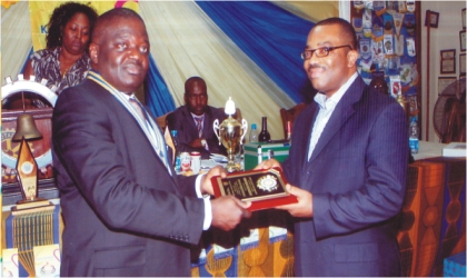 President Rotary Club of Port Harcourt 2011/2012 District 9140, Rtn Dominic Okafor (left) presenting Rotary Club Meritorious Award to Mr Celestine Ogolo, General Manager, Rivers State Newspaper Corporation in Port Harcourt, last Monday. Photo; Chris Monyanaga