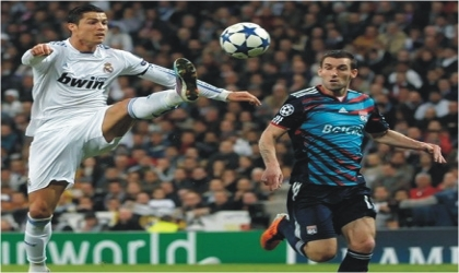 Real Madrid's Cristiano Ronaldo showing deft control in a champions League tie. Real whipped Lyon 4-0 at Bernabeu last night