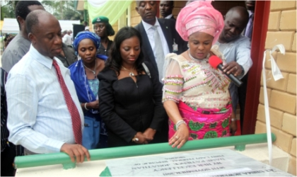 First Lady, Dame Patience Jonathan (right) commissioning an Empowerment Support Initiative(ESI) model nursery school while Rivers State Governor, Rt. Hon. Chibuike Rotimi Amaechi (left) and his wife, Founder of ESI, Judith watch, in Ubima, Rivers State, over the weekend.