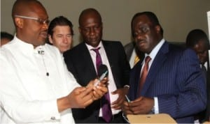 L-R:Rivers State Commissioner for Health, Dr. Sampson Parker displaying a syringe, Managing Director, Pan Africa Health Foundation, Auston Novotry,  Executive Secretary of the Foundation, Amenya Wokoma and NAFDAC Director General, Paul Orhii during a facility tour of the Rivers State Syringe and other Medical Devices Factory in Port Harcourt, yesterday.