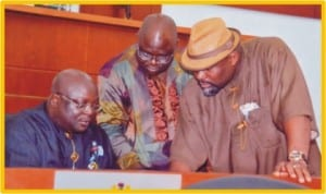Speaker, Rivers State House of Assembly, Rt. Hon. Otelemaba Amachree (left), former Speaker, Rt. Hon Tonye Harry (middle) and Leder of the House, Hon. Chidi Lloyd, scrutinising the 2013 Appropriation Bill prior to its passage, recently. Photo: Chris Monyanaga