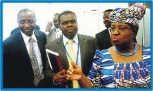 L-R: World Bank Executive Director, Dr Mansur Muhtar, Director-General, Budget Office, Dr Bright Okogu and Minister of Finance, Dr Ngozi Okonjo-Iweala, at a news briefing on the on-going spring meeting of the World Bank and the IMF in Washington DC last Friday.