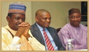 """L-R: Minister of Information, Mr Labaran Maku, former Governor of Abia State, Dr Orji Kalu and President, Nigeria Union of Journalists, Malam Mohammed Garuba, at a public lecture and launch of the book titled """"Guide to Youth Self Employment"""" in Abuja, yesterday."""