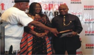 Former National President of NUJ, Mr. Ndagene Akwu(left),  Andy Briggs Most outstanding Government Spokesman Award to Hon. Ibim Semenitari, Commissioner for Information and Communications (middle) during a ceremony tat Le Meridian Hotel, in Port Harcourt, recently.