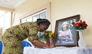 Wife of the Rivers State Governor Dame Judith Amaechi signing the condolence register during a condolence visit to First Lady Dame Patience Jonathan over the death of her mother.