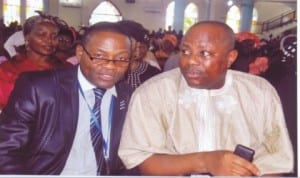 Director, Rivers State Newspaper Corporation, Chief Clinton Dagogo (right), with Secretary, Central Planning Committee 2013 Civil Service Week, D.C Nweneka, during a thanksgiving service at St Cyprian's Anglican Church, Port Harcourt, recently