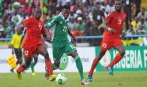 Super Eagles Nnamdi Oduamadi (12) taking Malawian opponent at the UJ Esuene Stadium, Calabar, last Saturday