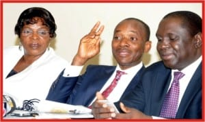 L-R: Commissioner for Engineering, Safety and Standards, Nigerian Electricity Regulatory Commission, Mrs Mary Awolokun, Chief Executive Officer, Mr Sam Amadi and Commissioner for Legal, Licence and Enforcement, Mr Steven Andzenge, at a workshop on Nigerian Electricity Health and Safety Code in Abuja, Wednesday