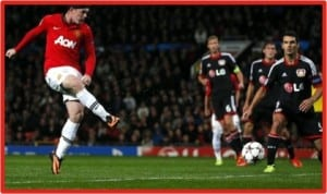 Wayne Rooney (left) scoring one of his two goals against Bayer Leverkusen at the Old Trafford, last night