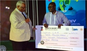 Associate Director, Global Engagement, University of Arkansas at Pine Bluff, United States of America, Dr Pamela D Moore (left), presenting the winner's prize of three million naira  for the International Heritages Parade to the Chairman of Okrika Local Government Area, Barrister Tamuno Williams in Port Harcourt, yesterday Photo: Chris Monyanaga