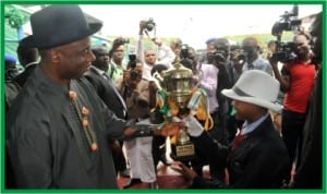 Governor Chibuike Rotimi Amaechi of Rivers State (left), presenting a trophy to a pupil, during the Independence Day celebration in Port Harcourt, yesterday